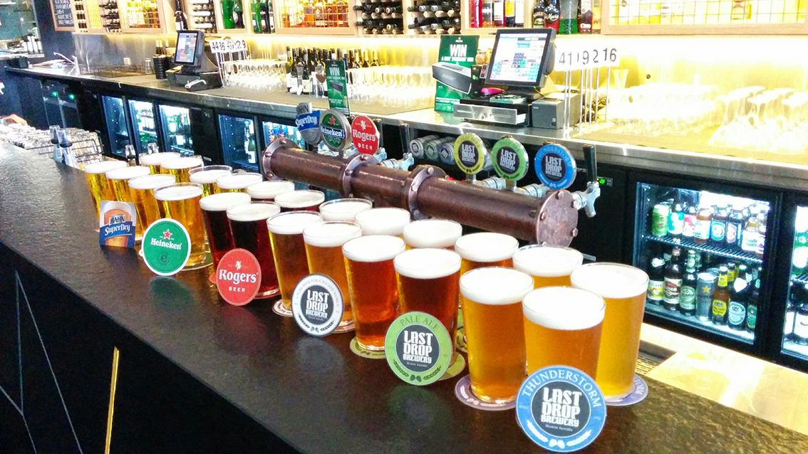 Assortment of beers available at Gramercy Bar and Grill in Perth CBD displayed in full pint glasses on counter top