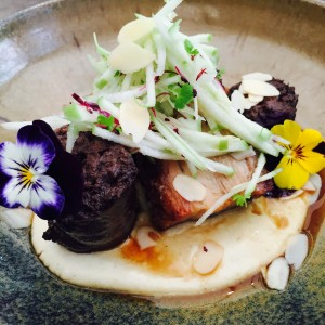 Lovely pork belly dish with decorative flowers at Perth CBD Bar Gramercy